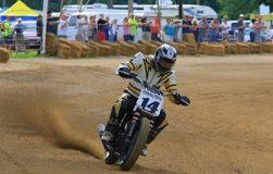 Dirt oval track racing. Motorcycle racer attempts to control the bike on the turn at the pro motorcycle racing event on the dirt oval track speedway, Ashland Royalty Free Stock Photo