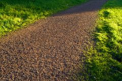 Dirt Path. A dirt and grass grass at sunset Royalty Free Stock Photo
