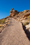 Dirt path way up to hill Stock Photos