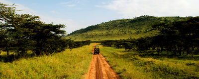 Dirt road. A jeep traveling on a dirt road in africa stock photos