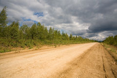 Dirt road. A dirt road in a sparsely populated area royalty free stock photography