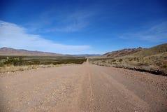 Dirt Road. Long dirt road in rural nevada desert Royalty Free Stock Photo