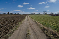 Dirt road. In a rural landscape Stock Photos