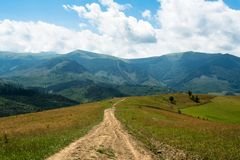 Dirt road against the landscape in the Ukrainian Carpathians Royalty Free Stock Photography