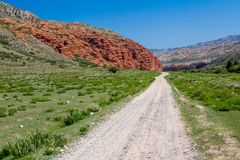Dirt road along amazing rock formations Royalty Free Stock Photo