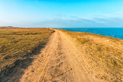 Dirt road along the coast Stock Photos