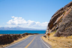 Dirt road along the coast of Lake Titicaca near Copacabana, Bolivia Royalty Free Stock Photography