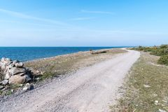 Dirt road along the coast Stock Photos