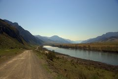 Dirt road along the Katun riverbed. Altai, Siberia, Russia. Landscape royalty free stock photos