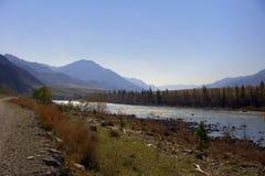 Dirt road along the Katun riverbed. Altai, Siberia, Russia. Landscape stock photo