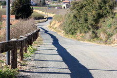 Dirt road amidst fences Royalty Free Stock Photography