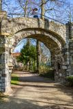 Dirt road and the arch of an old stone bridge with a woman in it taking a picture. A dirt road in the Proosdij park, a wonderful and sunny day in Meerssen stock photos