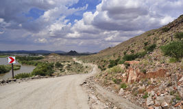 Dirt road in the arid landcape Royalty Free Stock Images