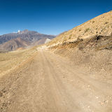 Dirt road through arid mountain wastelands. Muktinath region in Nepal Stock Photo