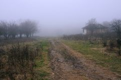Dirt Road in the Balkans. Foggy fuzzy view of the dirt road in the village in the Balkans royalty free stock photo