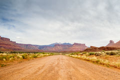 Dirt road through beautiful barren land Stock Photography