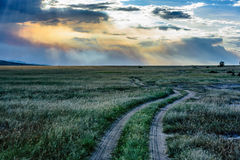 Dirt road with beautiful sky and clouds in Kenya, Africa Royalty Free Stock Photos