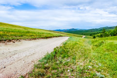 Dirt road in Central Mongolian steppe Royalty Free Stock Photos