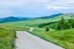 Dirt road, central Mongolian steppe Royalty Free Stock Images