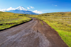 Dirt Road and Cotopaxi Volcano Stock Photo