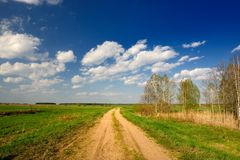 Dirt Road in Countryside Stock Photos