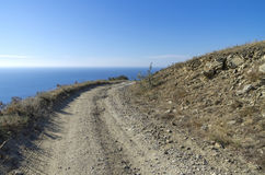 Dirt road in the Crimean mountains. Stock Photos