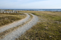 Dirt road curve. By the coast of Baltic Sea at the island Oland in Sweden royalty free stock photos