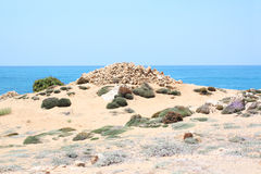 Dirt road on cyprus. With lighthouse during summer Royalty Free Stock Photos