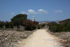 Dirt road on cyprus. With lighthouse during summer stock photos