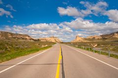 Old Oregon Trail Road near Scotts Bluff National Monument. A highway follows the old Oregon Trail as it leads through Scotts Bluff National Monument in western stock photo
