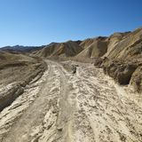 Dirt road in Death Valley National Park. Royalty Free Stock Photo