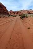 Dirt road in desert Stock Images