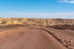 Dirt road in desert Negev, Israel,  transport infrastructure in. Desert, scenic mountains route from Eilat to north of Israel Royalty Free Stock Photos