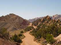 Dirt road into desert valley. Dirt road weaves between exposed dry desert rock formations and ridges in Capitol Reef National Park Utah Stock Photography