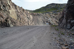 Dirt road in development of mountain rocky breeds. Kola Peninsula Royalty Free Stock Photos