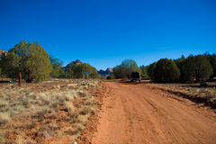 Dirt road through the dry land Royalty Free Stock Images
