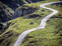 Dirt road. At the european alps Royalty Free Stock Images