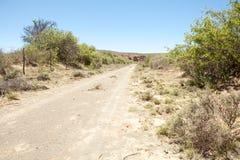 Dirt road on farm in arid region Stock Images