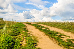 Dirt road in a field Royalty Free Stock Photos