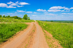 Dirt road in the field Royalty Free Stock Images