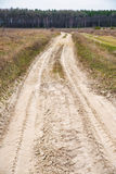Dirt road in the field Stock Images