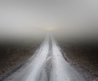 Dirt road in fog Royalty Free Stock Photography