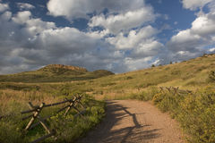 Dirt road at foothills of Rocky Mountains royalty free stock photo