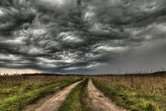 Dirt road going into the eye of the storm Royalty Free Stock Photo