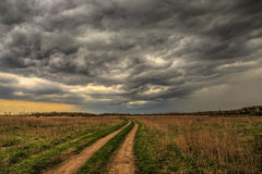 Dirt road going into the eye of the storm Stock Photography