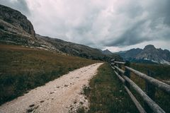 Dirt road and hiking trail track in Dolomites mountain stock photo