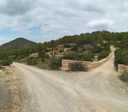Dirt road. hinterland of the island of ibiza. crossroads. bifurcation stock photos