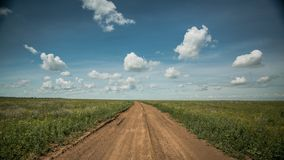 Dirt road into the horizon royalty free stock photography