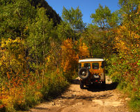 Dirt road and Jeep. Deep into the mountains of Colorado Stock Images
