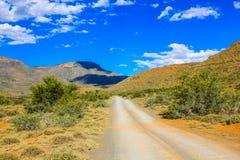 Dirt road in Karoo National Park Royalty Free Stock Images